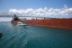 An ore boat traveling through the Soo Locks