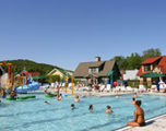 Crystal Mountain offers a one-acre complex featuring a large outdoor water playground with water cannons and bubbling spouts; plus a zero-depth entry pool, lap lanes, water volleyball, basketball and vertical edge climbing wall.