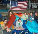 Diocese of Gaylord pilgrims trying to keep warm while camping out on the Copacabana Beach, awaiting the Closing Mass.