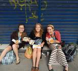 Shannon Scott, Abbie Scheske, and Katie Hoffman pose while taking a break for lunch in downtown Rio.