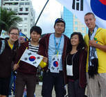 Shannon Scott and Jake Blanzy pose with new friends from South Korea.