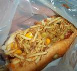 While hot dogs were offered in Rio, the toppings were different than most Americans choose. This particular hot dog has peas, potato chips, and corn. Other toppings included raisins, carrots, and mayonnaise.