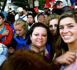 Katie LeBlanc, Priscilla Oddo, Chrissy Smith, and Lorelei Grant squished into a barrier with people surrounding - all to see Pope Francis up close!