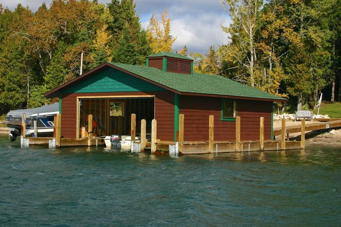 A boathouse painted to complement the surrounding natural environment