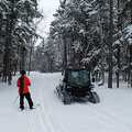 A skier pauses to talk to the groomer on the Heritage Trail.