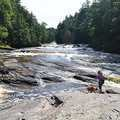 Enjoying the wild waters of Presque Isle River.
