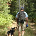 A hiker and his dog head down the trail in Green Timbers.