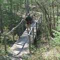 Crossing a bridge on the pathway built by the Boy Scouts.