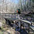 Crossing a foot bridge along the North Country Trail.