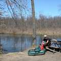 A trout angler prepares to fish the Huron River.