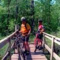 Mountain bikers on a bridge in Pinckney Recreation Area.