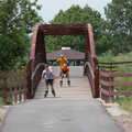 In-line skaters cross a bridge from the Sterling Marsh Trail