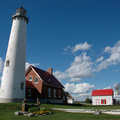 Tawas Point Lighthouse seen along the Sandy Hook Trail.