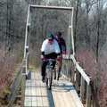 Mountain bikers cross a trail bridge at Bald Mountain.
