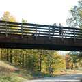 Bikers pause along the Benington rail-trail bridge.
