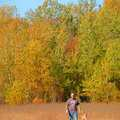 A hiker and his dog at DeYoung Natural Area.
