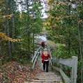 Hikers head down a set of stairs along Sabin Pond Trail.
