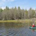 An angler fishes Deer Lake from a float tube.