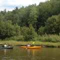 Kayakers floating through the Brown Bridge Quiet Area.