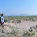 A hiker pauses along Platte Bay.