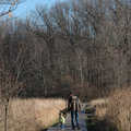 Father and son follow a boardwalk at Lake Lansing-North.