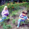 Young hikers picking wild berries along Deadman's Loop.