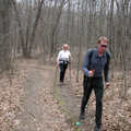 Hikers, using trekking poles, follow the Wilderness Trail.
