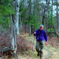 A hiker on the Mason Tract Pathway.
