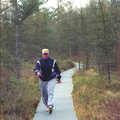 Hiker following Bishop's Bog Trail.