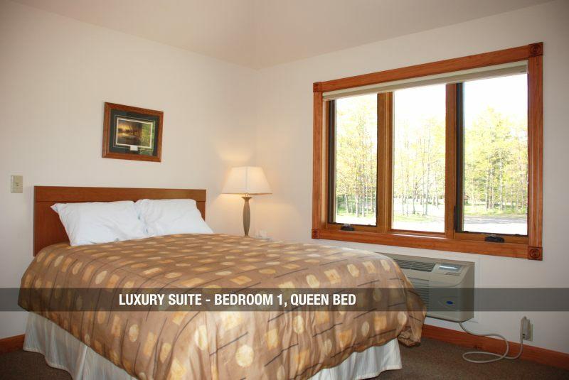 Luxury Suite - Bedroom 1 Queen Bed & Root Cellar Resort u0026 Restaurant - UP Travel