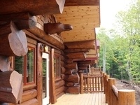 Front porch of Aqua log cabin resort on the water