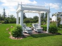 Sun yourself in our wicker chaise in the garden Pergola.