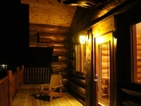 Aqua log cabin front porch