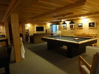 Lower level TV area with wet bar, seating and pool table