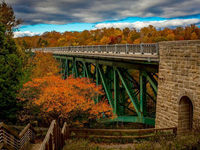 One of only two cantilevered deck truss bridges in Michigan, Cut River Bridge is a perfect place to view the golden autumn season.