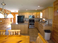 Full kitchen with dishes in cabins!