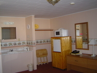 Microwave and Refrigerator in all rooms